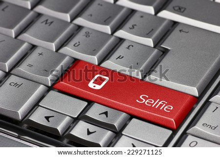 Computer key - Selfie with a smart phone  - stock photo