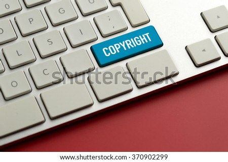 Computer key showing the word COPYRIGHT - stock photo