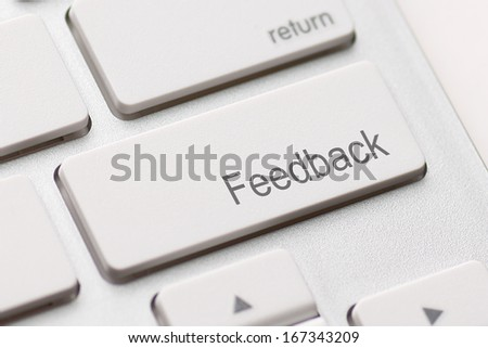 Computer key showing the word Feedback. Message on keyboard key.