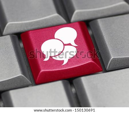 Computer key - text balloon suggesting social media - stock photo