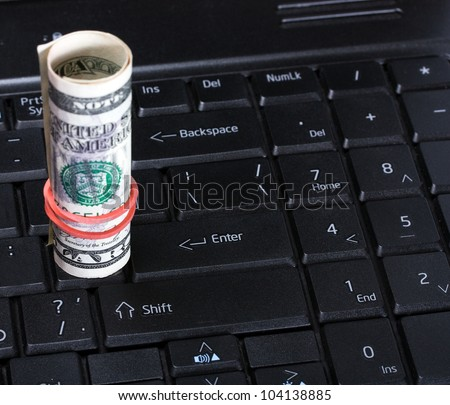 Computer keyboard and dollar money background