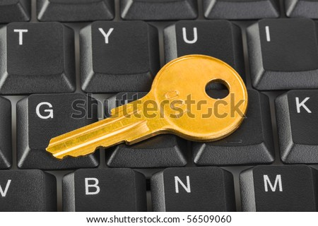 Computer keyboard and key - technology security concept - stock photo