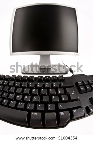 computer keyboard and monitor on a white background