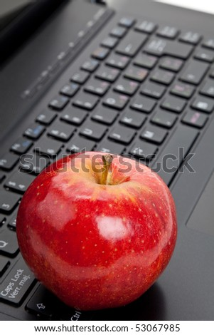 Computer Keyboard and red apple close up - stock photo