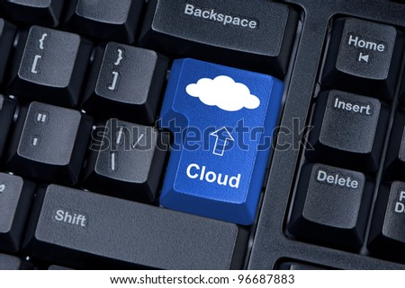 """Computer keyboard button blue color with cloud. Concept of computer systems located in the """"cloud"""" - stock photo"""