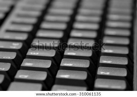 Computer keyboard. Close up of mostly blurred bands of keys.