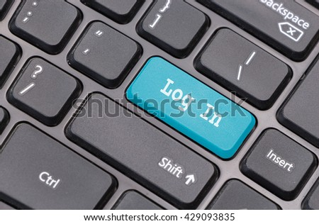 "Computer keyboard closeup with ""Log In"" text on blue enter key - stock photo"