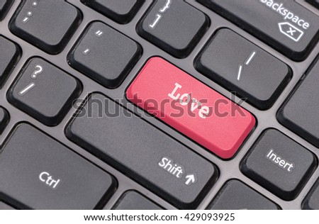 "Computer keyboard closeup with ""Love"" text on red  enter key - stock photo"