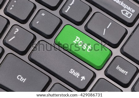"Computer keyboard closeup with ""Post"" text on green enter key - stock photo"