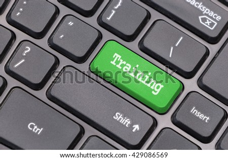 """Computer keyboard closeup with """"Training"""" text on green enter key - stock photo"""
