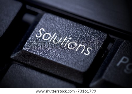"Computer keyboard concept Image with keyword ""solutions""."