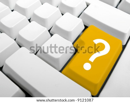 Computer keyboard. Enter key replace with yellow interrrogation key. Question key concept. - stock photo