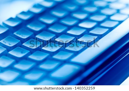 computer keyboard in blue ambiance - stock photo