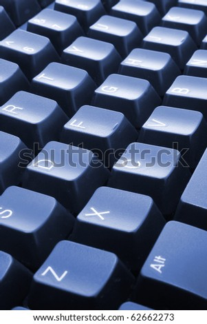 Computer Keyboard in Blue Tone - stock photo
