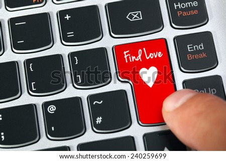 Computer keyboard key with find love and heart icon concept for online internet dating - stock photo