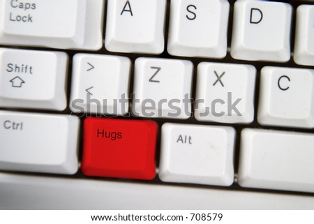 computer keyboard key with the word hug on it highlighted in red