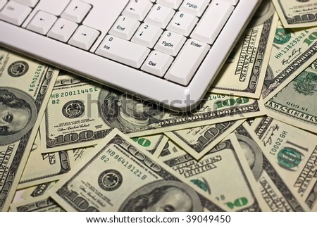 Computer keyboard on the $100 banknotes background