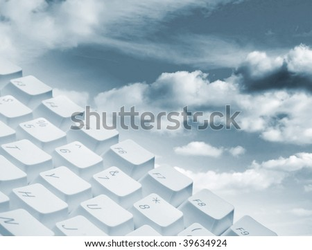 Computer keyboard overlaid over cloudy sky background - stock photo