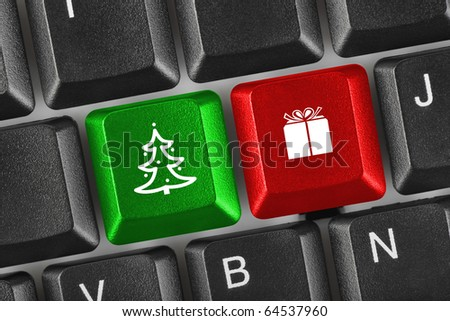 Computer keyboard with Christmas keys - holiday concept - stock photo