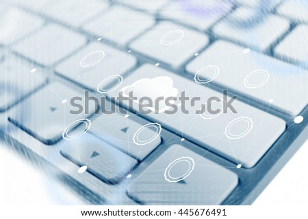 Computer keyboard with cloud data storage and multimedia icons - stock photo