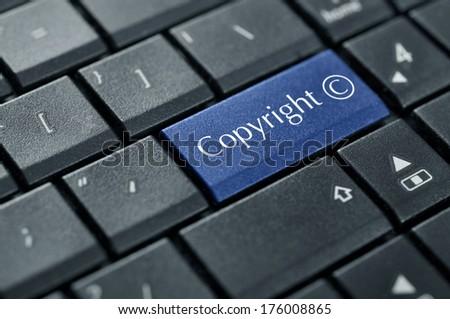 Computer keyboard with Copyright symbol closeup - stock photo