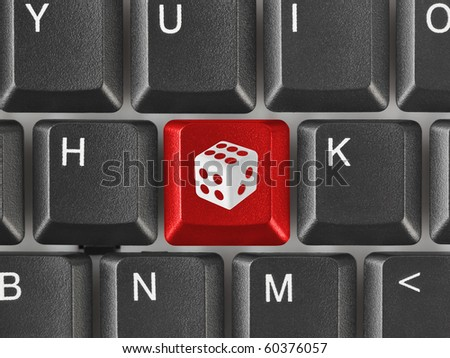 Computer keyboard with dice key - technology background - stock photo