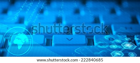 Computer keyboard with glowing globe and multimedia icons - stock photo