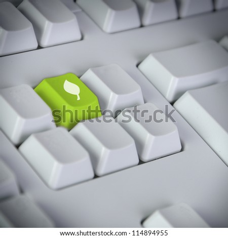 Computer keyboard with green Enter key with recycling symbol business concept - stock photo