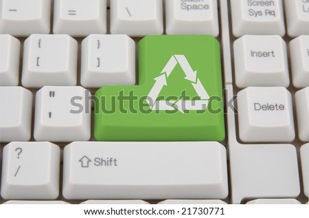 Computer keyboard with green Enter key with recycling  symbol, business concept - stock photo