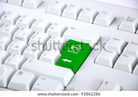 Computer keyboard with house symbol on it - stock photo