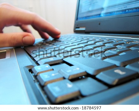 computer keyboard with human hand closeup - stock photo