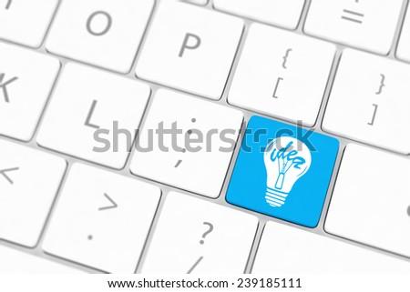 Computer keyboard with lamp key - stock photo