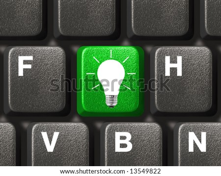 Computer keyboard with lamp key, technology background - stock photo