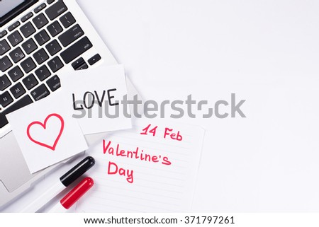 Computer keyboard with notice february 14 is Valentine's day with copy space on white background - stock photo