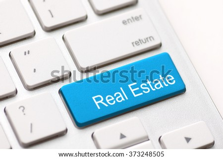 Computer keyboard with real estate key. - stock photo