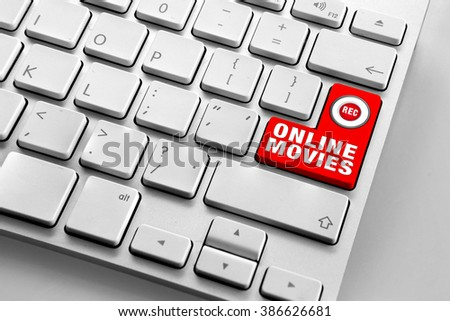 Computer keyboard with red online movies button