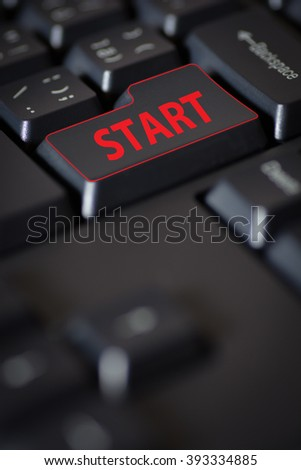 Computer keyboard with start title in red color. Shallow DOF. - stock photo
