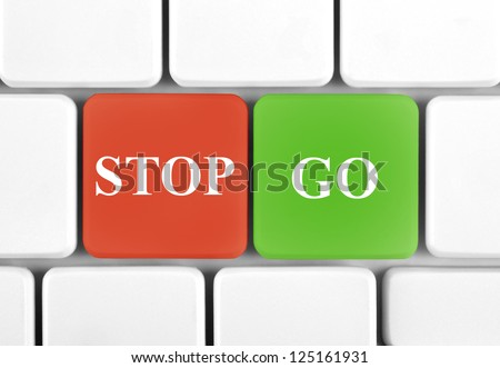 Computer keyboard with stop and go symbol on it - stock photo