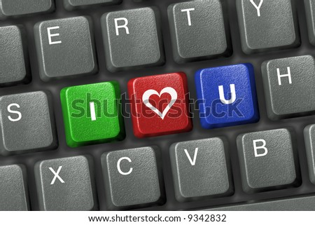 Computer keyboard with three love keys - stock photo