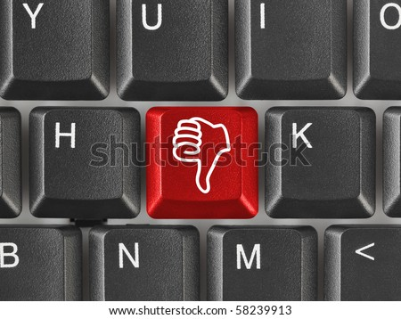 Computer keyboard with thumb gesturing hand key - stock photo