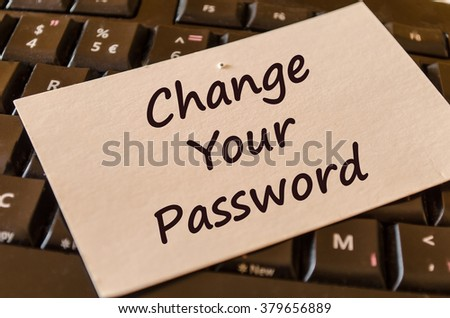 Computer Keyboard with white note and text change your password - stock photo