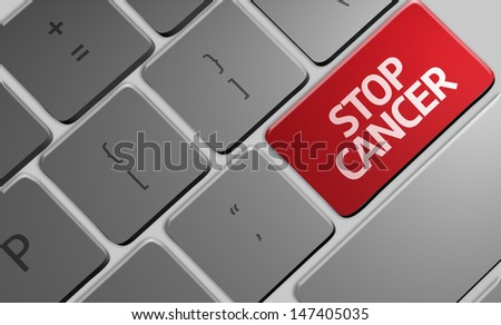 Computer keyboard with word Stop Cancer  - stock photo