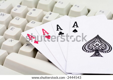 computer keys and cards, concept of online card games - stock photo