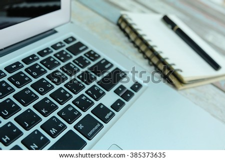 Computer laptop and note book, green tone