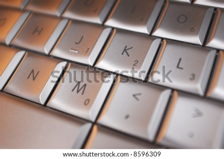 computer laptop keyboard in close up - stock photo