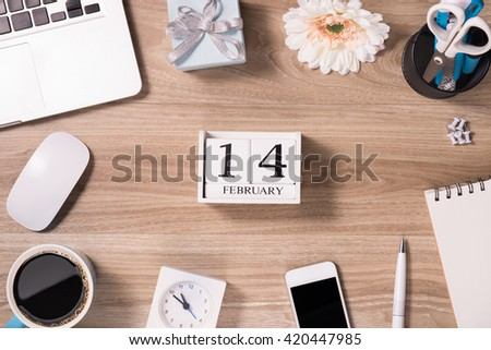 Computer, laptop keyboard with notice that february 14 is Valentine's day. Reminder with calendar blocks with love. - stock photo