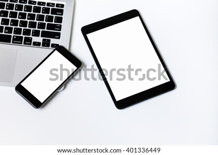 Computer laptop tablet and smart phone on white background  - stock photo