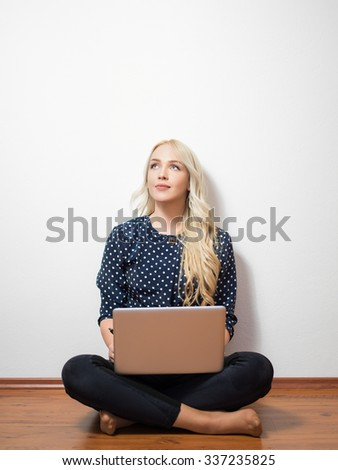 Computer. Laptop.Woman.Girl. Businesswoman.Girl working at the laptop. Studio.White background.Space.Smiling. Education center. Business seminar. - stock photo