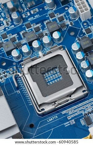 Computer mainboard with empty cpu socket - stock photo