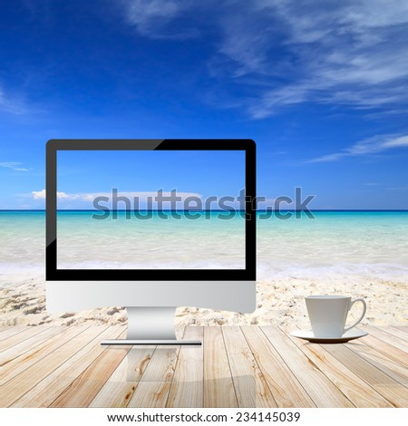 Computer Monitor on the beach background - stock photo